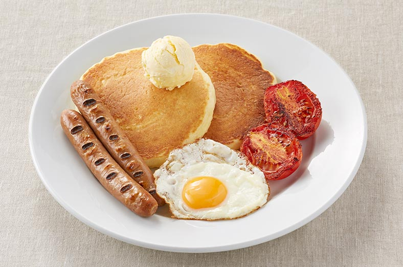 Pancakes, eggs, tomatoes, sausages