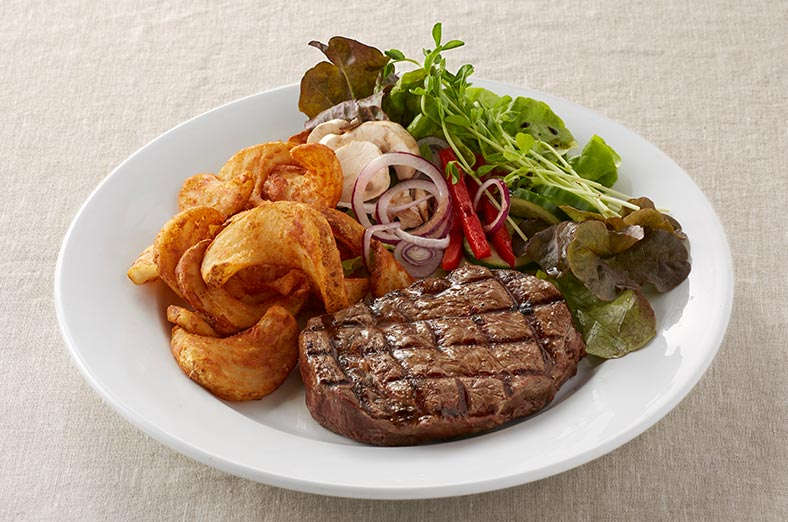 Ribeye steak, fries, salad