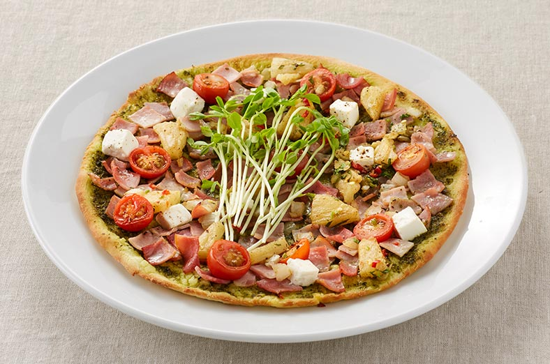 Pizza with smoked ham, pineapple and tomato