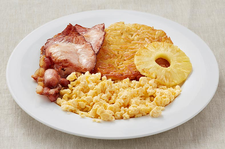 Scrambled egg, hashbrown, bacon, pineapple